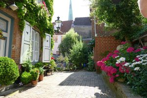 Beautiful, floral courtyard at the end of an alleyway.
