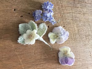 white and lilac, forgetments, violets and strawberry leaf with flower.